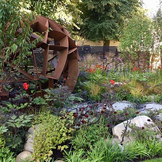 Geometric orb-shaped gazebo overlooks a garden