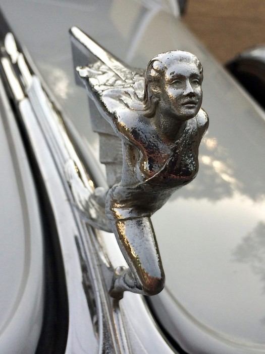 Female hood ornament with graceful posture