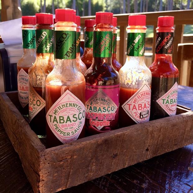 Bottles of Tabasco sauce in a wooden holder