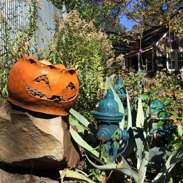 Halloween tyre planter with a face cut into it