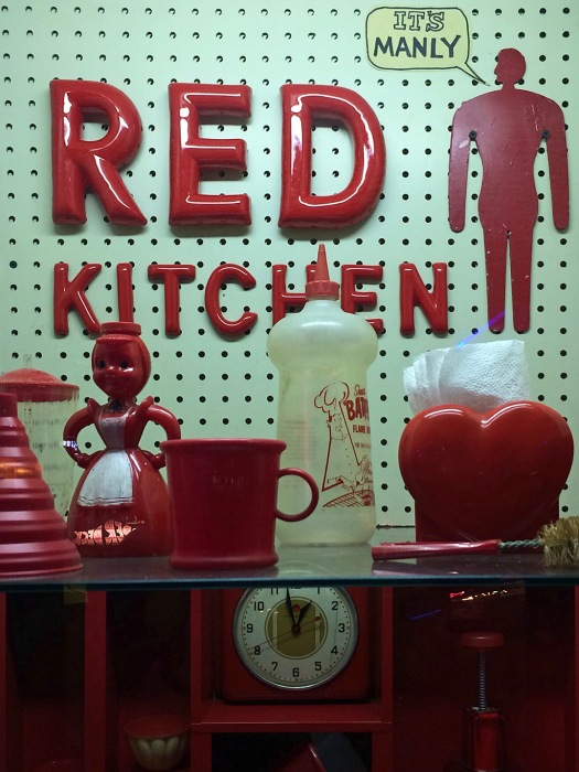 "Red kitchen items with the words ""It's manly"""