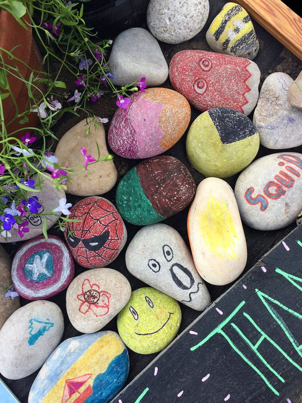 Squid, bee and spiderman designs on pebbles
