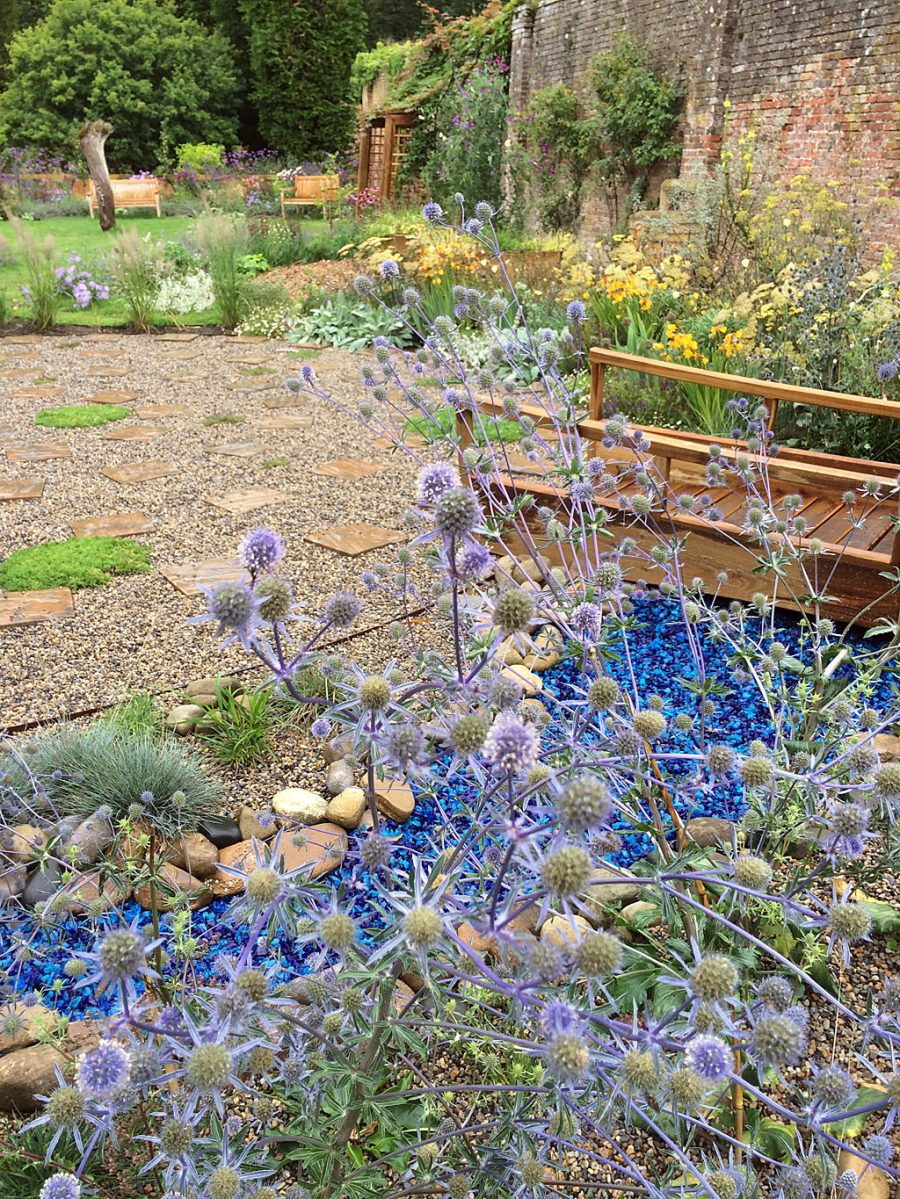Prickly flowers over a river of bold blue broken glass