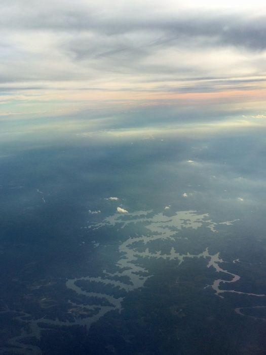 Hazy view of a meandering river from the air