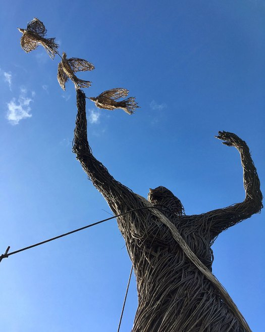 18ft tall willow woman holding three doves
