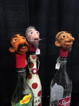 Bottle stoppers with felt faces