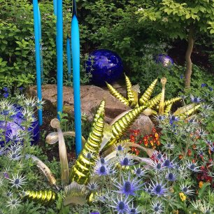 Gold, blue and clear art glass in a flower garden
