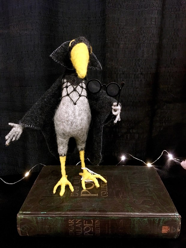 Felt crow in a black cape