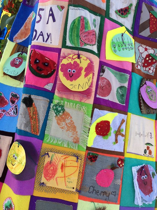 Fruit artwork squares, some with smiles drawn on them