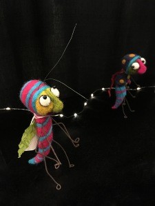 Two felt bugs, one eyeing the other