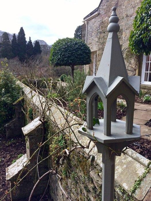 Grey painted bird feeder