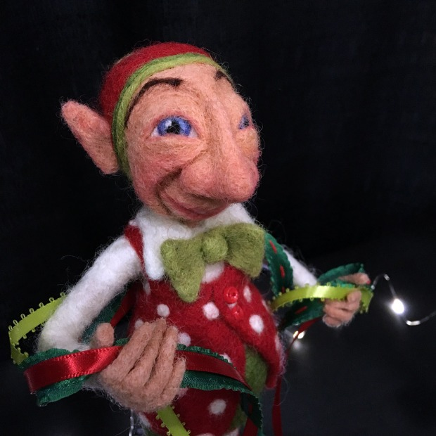Elf in Christmas costume with bow tie and ribbons