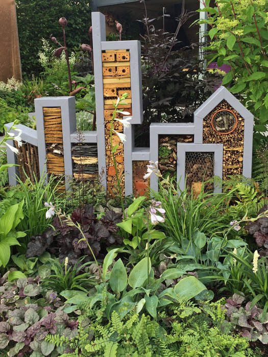 Bug hotel in the shape of a city skyline
