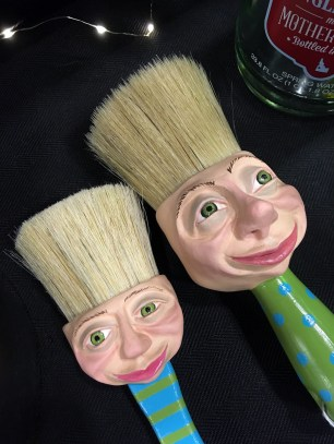 Paint brushes with smiling faces