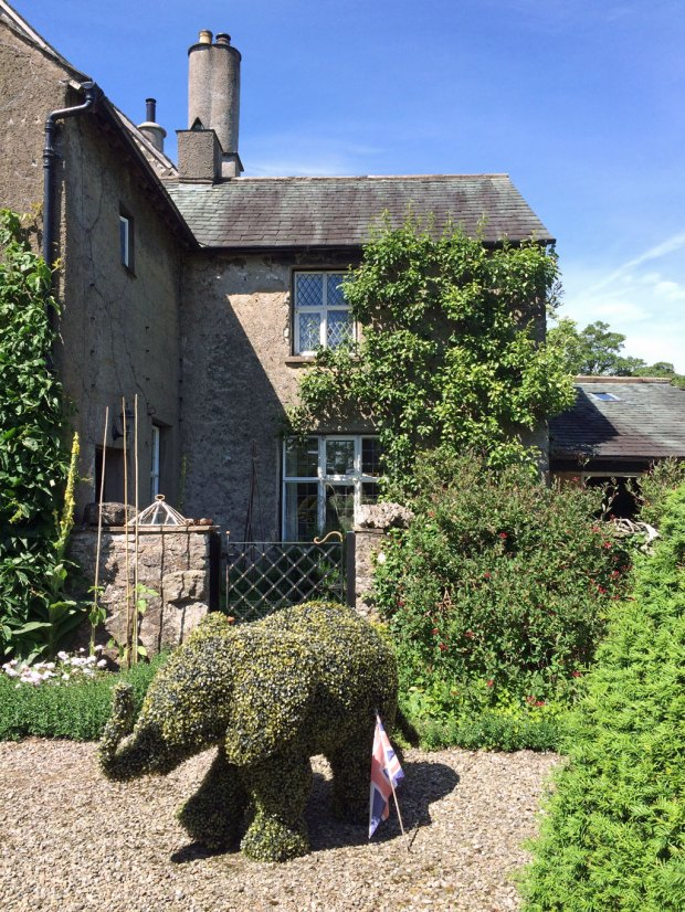 House with a topiary elephant
