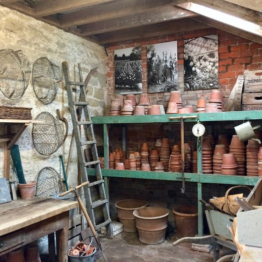 Stacked terracotta pots in a potting shed