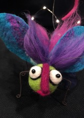 Butterfly with pink nose, green face and purple wings