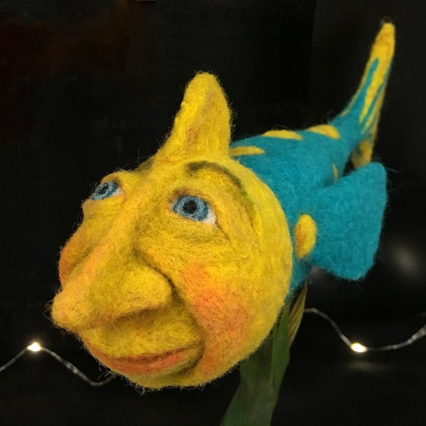 Felt art fish with human face