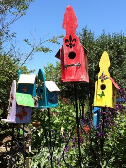 Red, yellow, blue and purple bird houses