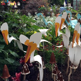 White metal pelicans and blue flamingos