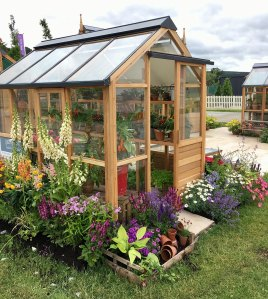 Gabriel Ash timber framed greenhouse with flowers
