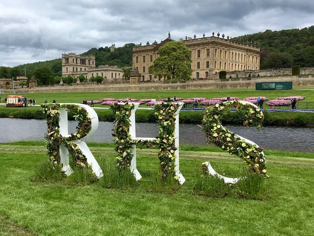 RHS floral logo with Chatsworth House in the background
