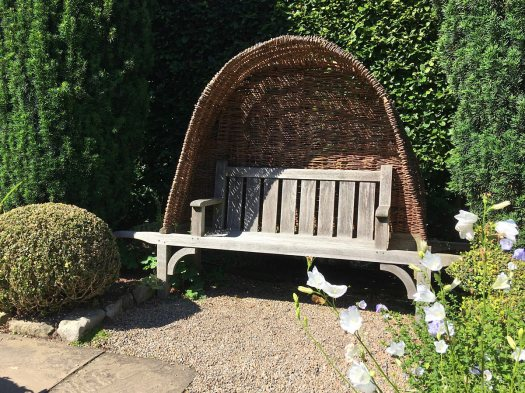 Beautiful wooden bench with wicker canopy