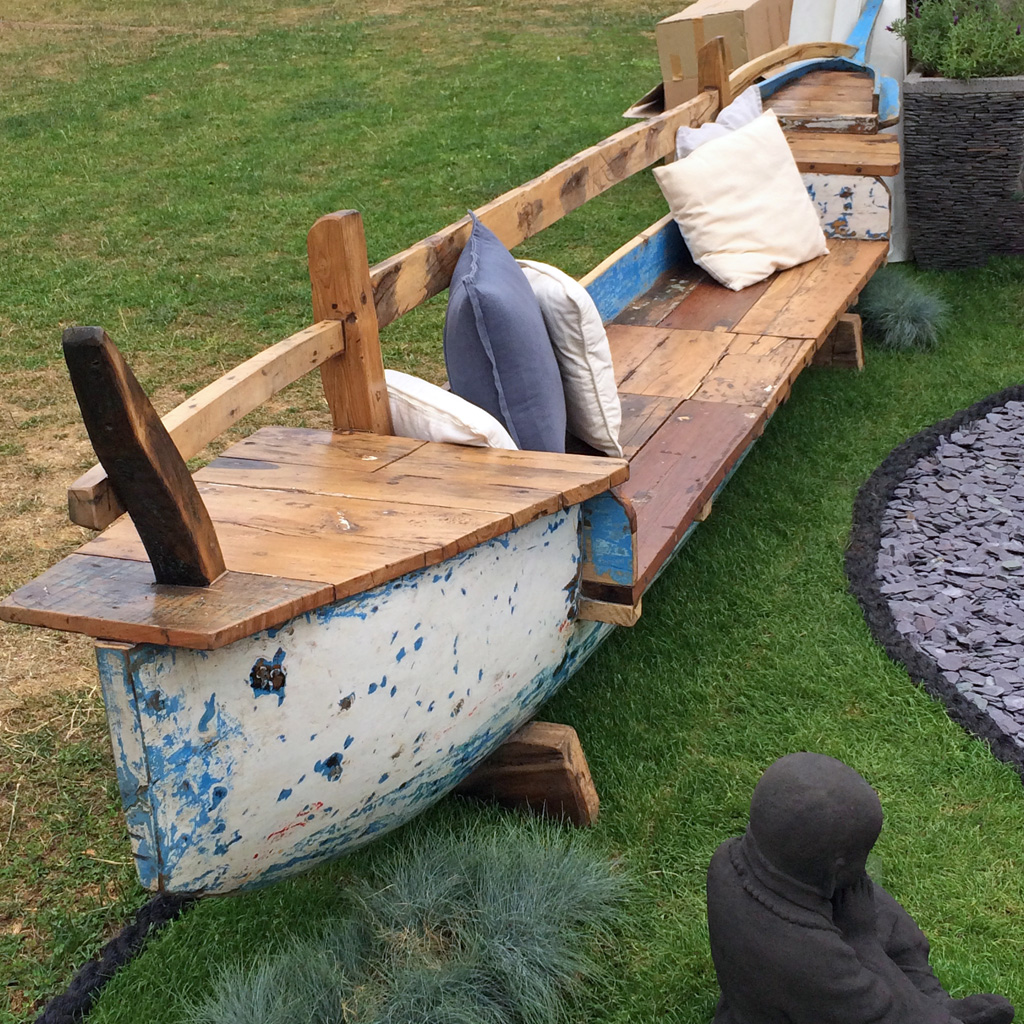 Canoe used to make a long, low garden seat