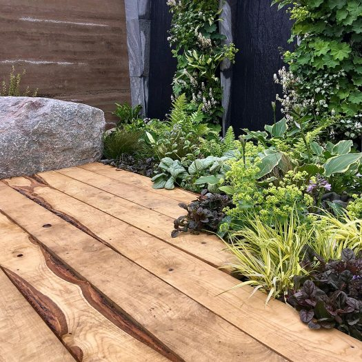 Eutierria garden with textural plants and sweet chestnut decking