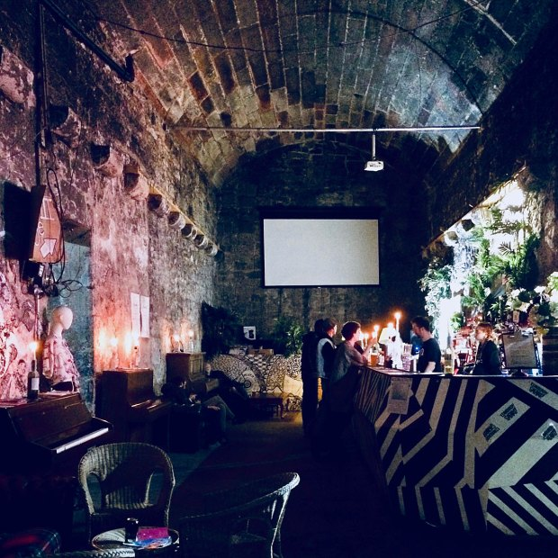 Edinburgh bar with an arched ceiling at night
