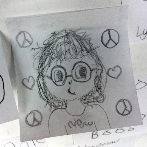 Pencil drawing of John Lennon with hearts and peace symbols