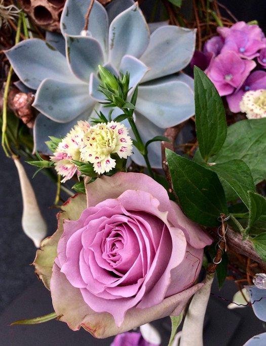 Flower arrangement with rose, dianthus, hydrangea and succulent