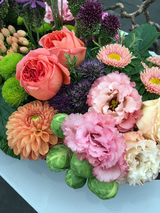 Orange roses, dahlias, lisianthus and brussels sprouts