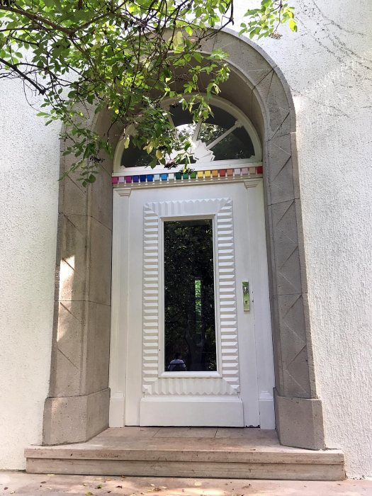 White door with arc window and colour chip border
