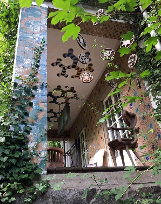 Haus Martinus's porch is decorated with tiles and motifs