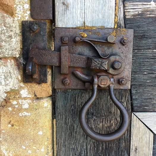 Blacksmith style handle, latch and bolt on an exterior door