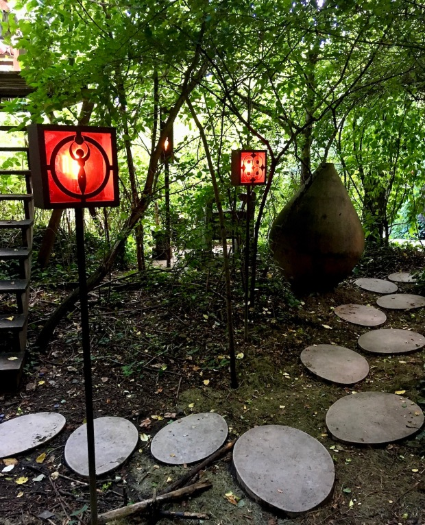 Egg-shaped paving stones wind through the garden, past a series of light boxes
