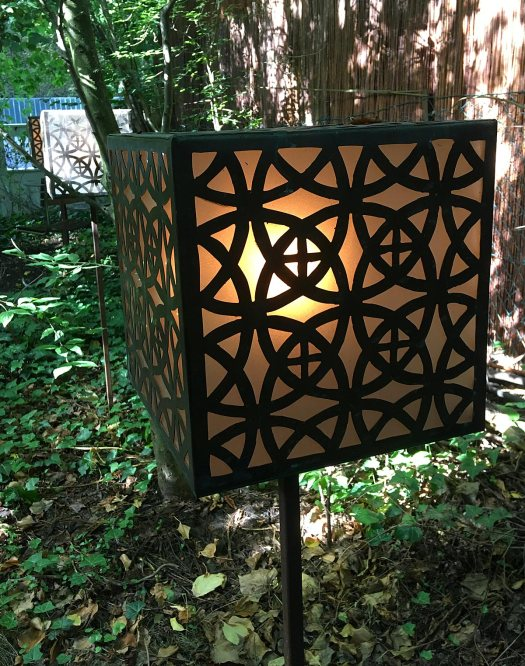 The vortex garden's lamps carry geometric patterns