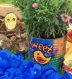 Tin can plant pot with bird design