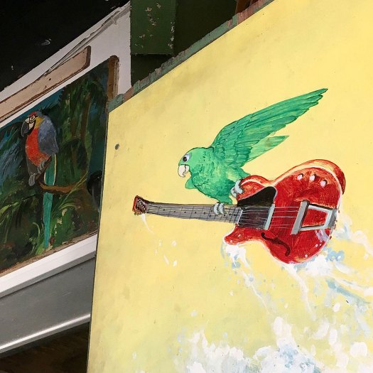 Green parrot and smoking guitar in a Key West bar