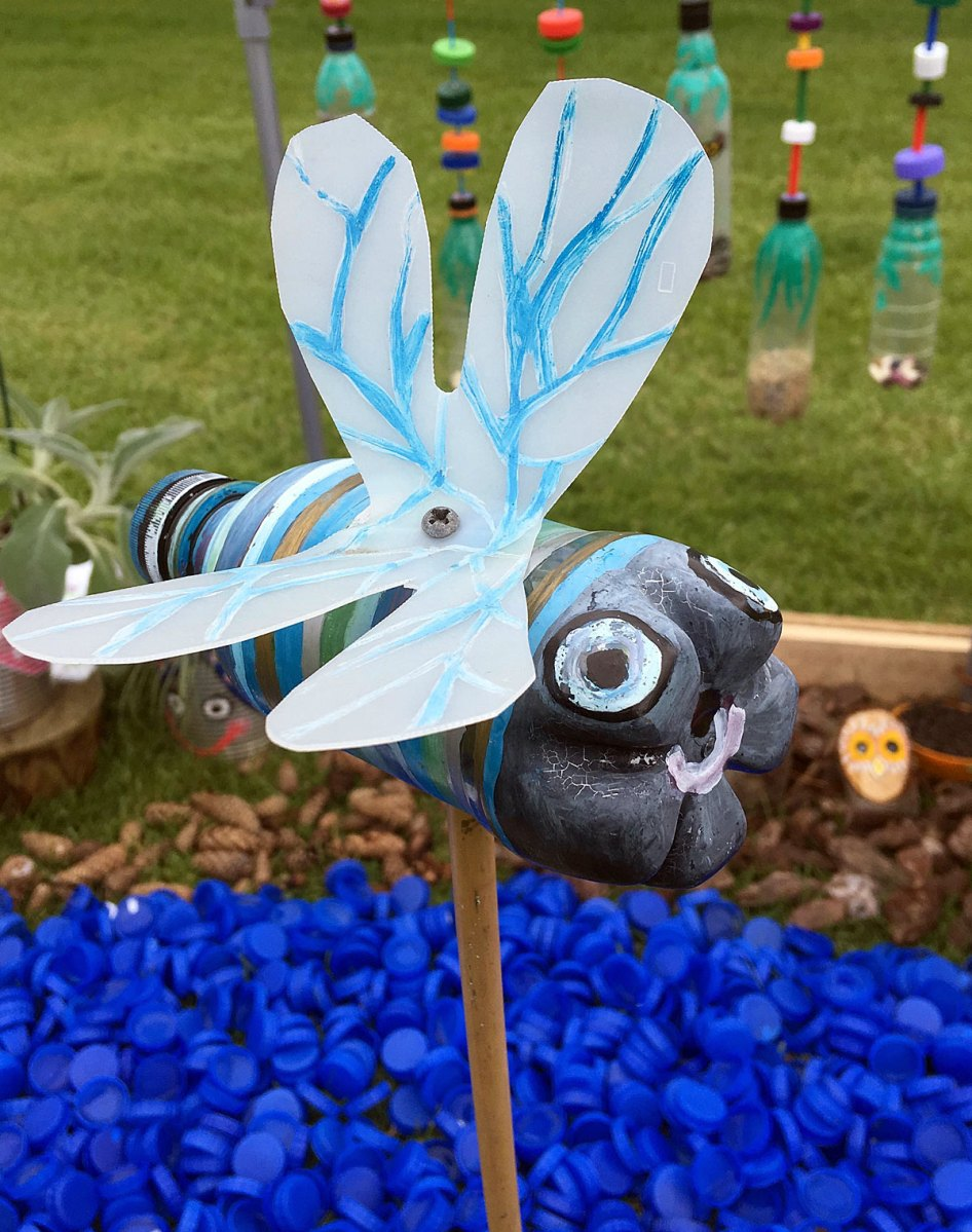 Striped insect made from a recycled bottle