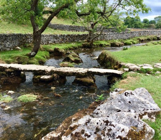 Bridge over a river in a landscape with dry stone walls