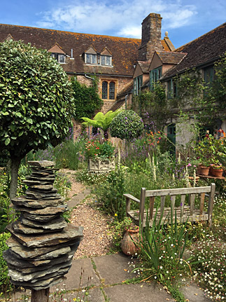 Picture of traditional house and overstuffed courtyard garden