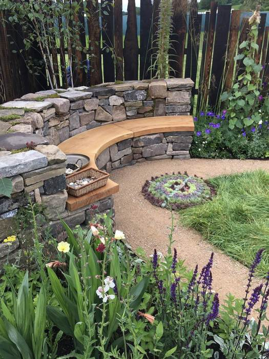 Curved dry stone wall bench with oak seat