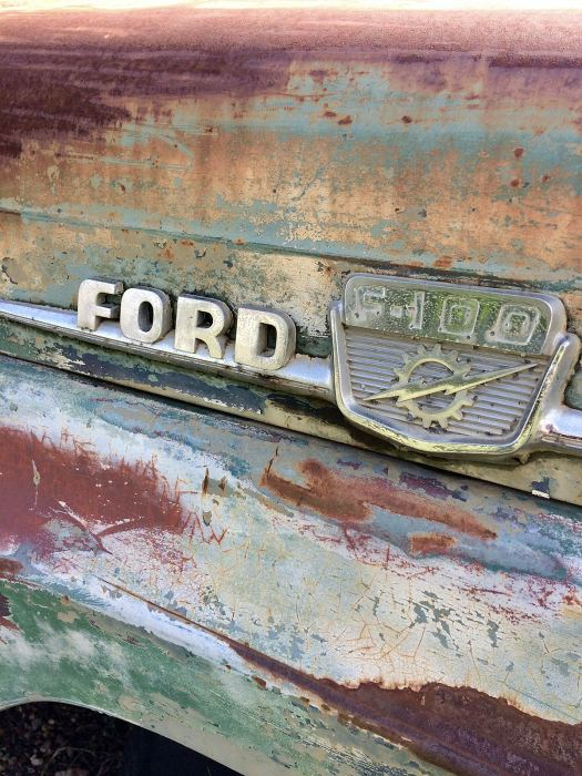 Ford logo on a rusty car
