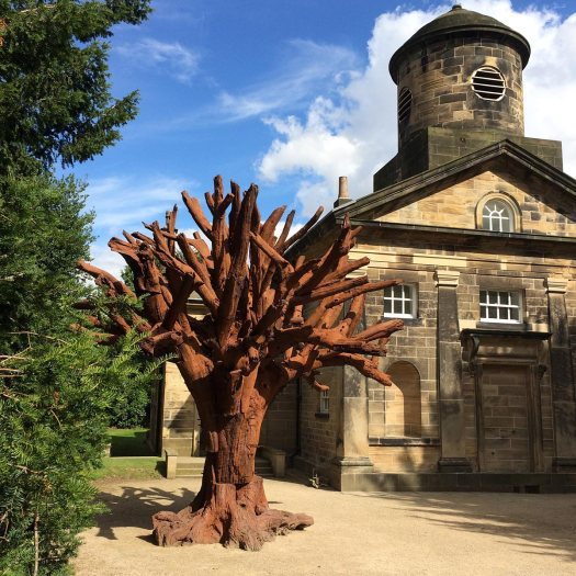 Iron Tree (2013) by Ai Weiwei - a pieced together tree - beside a chapel
