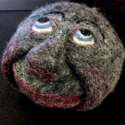 Felt stone with face - member of a rock group