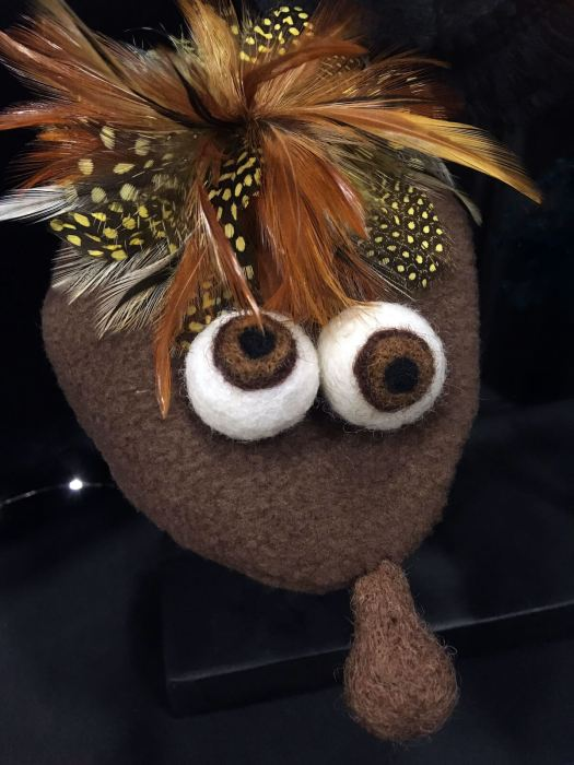 Brown glove puppet with feathery head