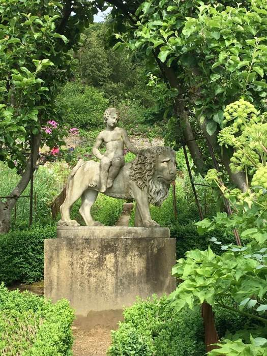 Statue of a child riding a lion in Chatsworth Kitchen garden