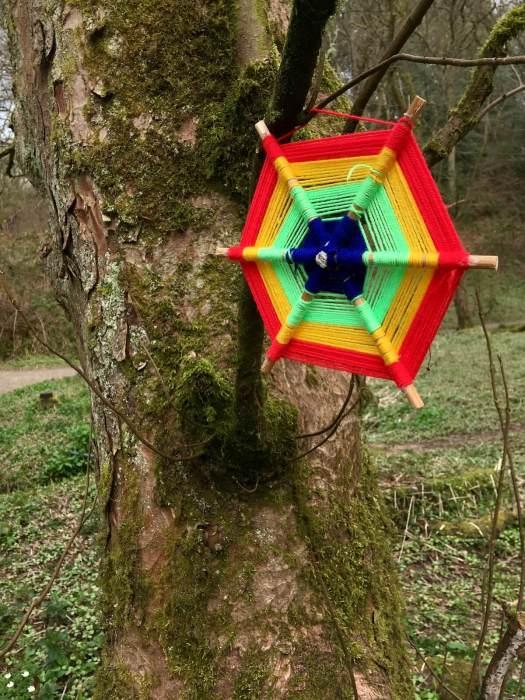 Yarn bombing - hexagon design left in a wood